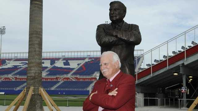 Howard Schnellenberger stands in front of a statue of himself on the southwest side of FAU's new 30,000-seat, on-campus football stadium. Schnellenberger led Miami to its first national title in 1983 and later helped start FAU's football team. (Florida Atlantic University)