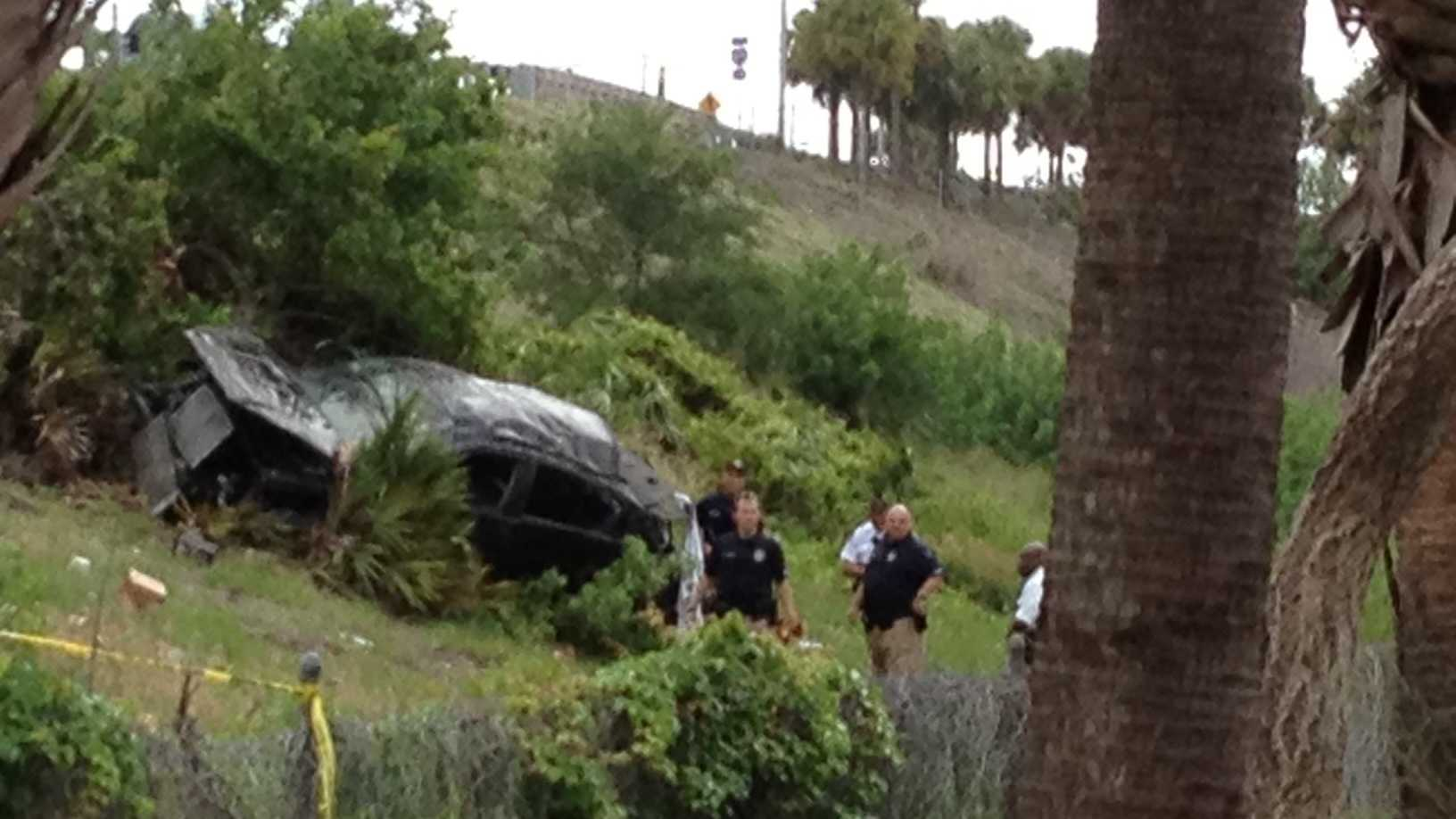Police say the suspects in a Dunkin' Donuts robbery crashed this car during a chase. (Angela Rozier/WPBF)