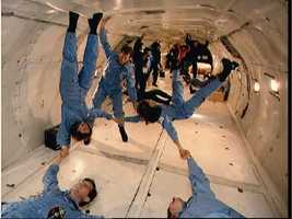 View of payload specialists in KC-135 during zero-g training