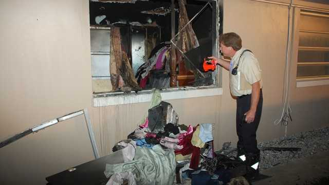 Fire inspector Gary Keidel inspects the damage to an apartment on West Camino Real. (Frank Corregio/Boca Raton Fire Rescue)