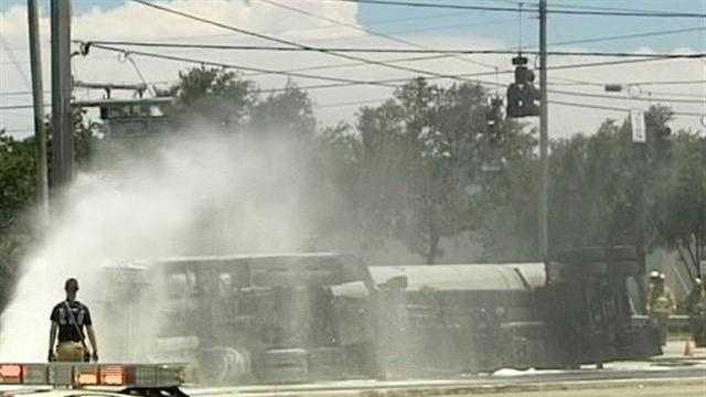 Fuel spills from overturned tanker truck