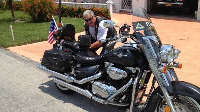 Richard Little, a member of the Patriot Guard, prepares for a ride to a funeral after discussing the Supreme Court's decision to strike down the Stolen Valor Act.