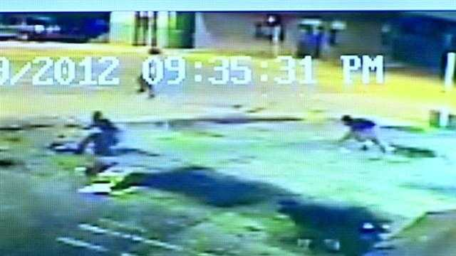 Surveillance video shows the gang-related shooting that left one man dead and three others in the hospital.