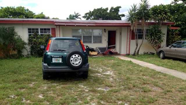 A woman returning to her home in Lake Worth on Thursday crashed into a man holding a baby. (Ted White/WPBF)