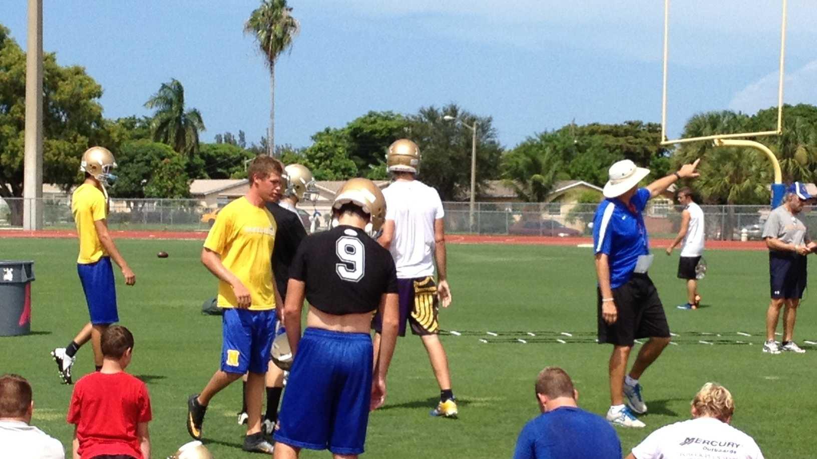 High school football players practice
