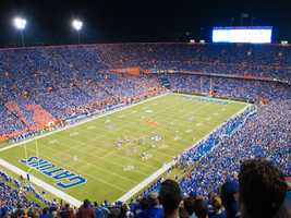 """Ben Hill Griffin Stadium has undergone a series of facelifts since being constructed in 1930, but every college football fan knows who plays in """"The Swamp."""" The home of the Florida Gators is the largest stadium in the state of Florida, with an official capacity of 88,548. (Photo: UF Communications)"""