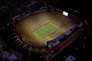 """Perhaps better known as """"The Big House,"""" Michigan Stadium seats 109,091, making it the largest stadium in the United States and third largest in the world.The stadium holds the NCAA record for largest crowd to watch a game for a bout with the Notre Dame Fighting Irish on Sept. 10, 2011.(Photo: University of Michigan Athletics)"""