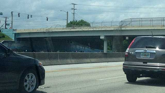 One person died when a car fell over an overpass on Florida's Turnpike in Boca Raton on Sunday afternoon. (Photo: u local/mobile)
