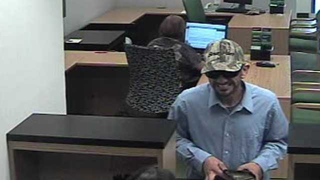 Detectives are trying to identify this man who robbed a TD Bank branch in Wellington.