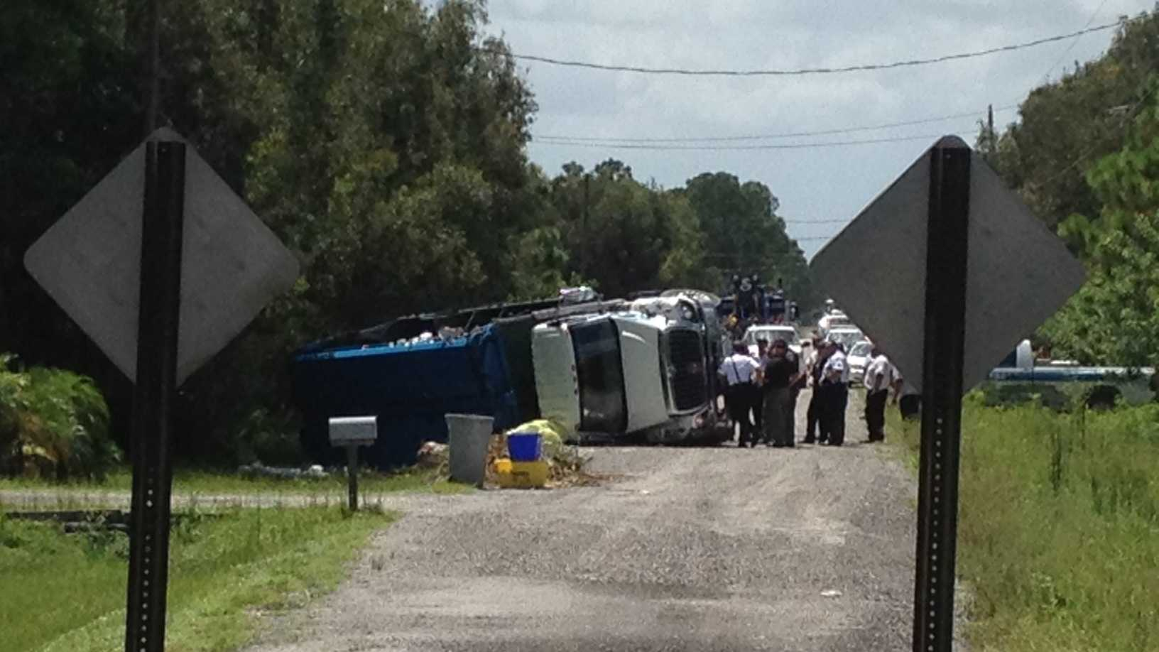 A garbage truck driver was killed in this rollover crash Friday afternoon.