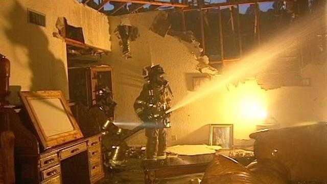 Neighbors say lightning may have sparked a house fire in Wellington.