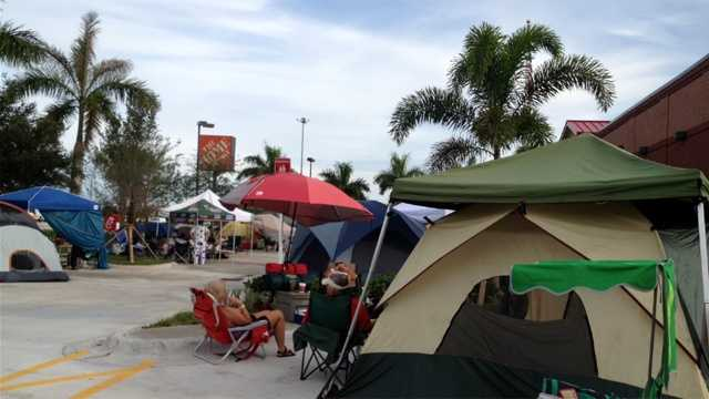 Dozens of Chick-fil-A fans are spending their Wednesday camping out in front of a new store, awaiting its grand opening set for Thursday morning. (Photo: Chris McGrath/WPBF)