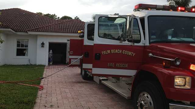 A Palm Beach County firefighter was injured when a section of the ceiling collapsed at this home in the Acreage.