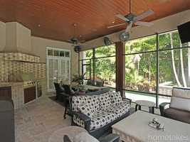 Lush palm trees provide shade and privacy for this rustic patio