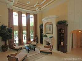 Beautifully sculpted, tiered ceilings.