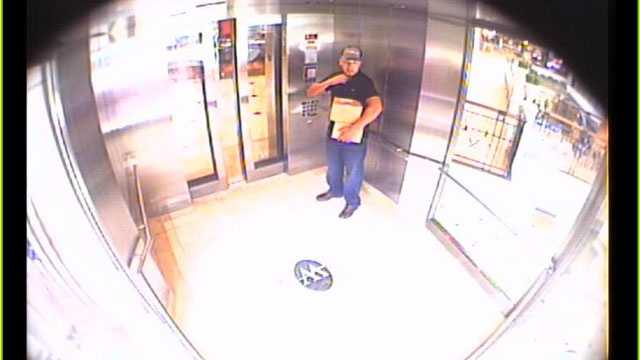 Detectives say this man walked out of the Sprint store inside the Mall at Wellington Green with two FedEx shipping boxes containing 73 recycled cellphones.