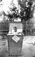 This child was captured in a basket with the sign Cabin Baggage attached to the front in the 1890s near DeLand.