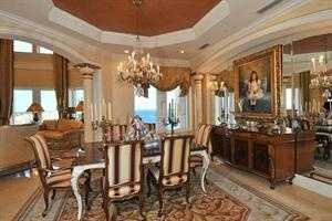 Formal dining room overlooking the water.