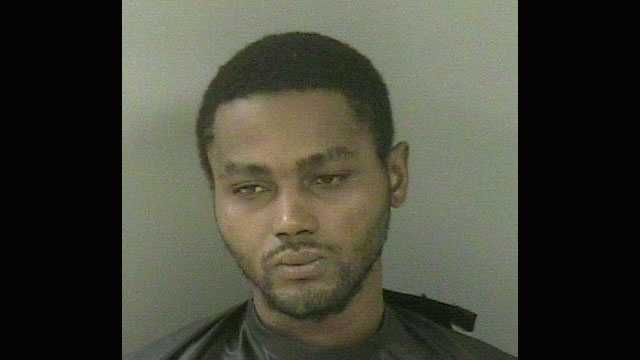 Domonque Allen was arrested after deputies said he entered a woman's home, stood over her while she slept and then tried to pull her back inside when she tried to escape.