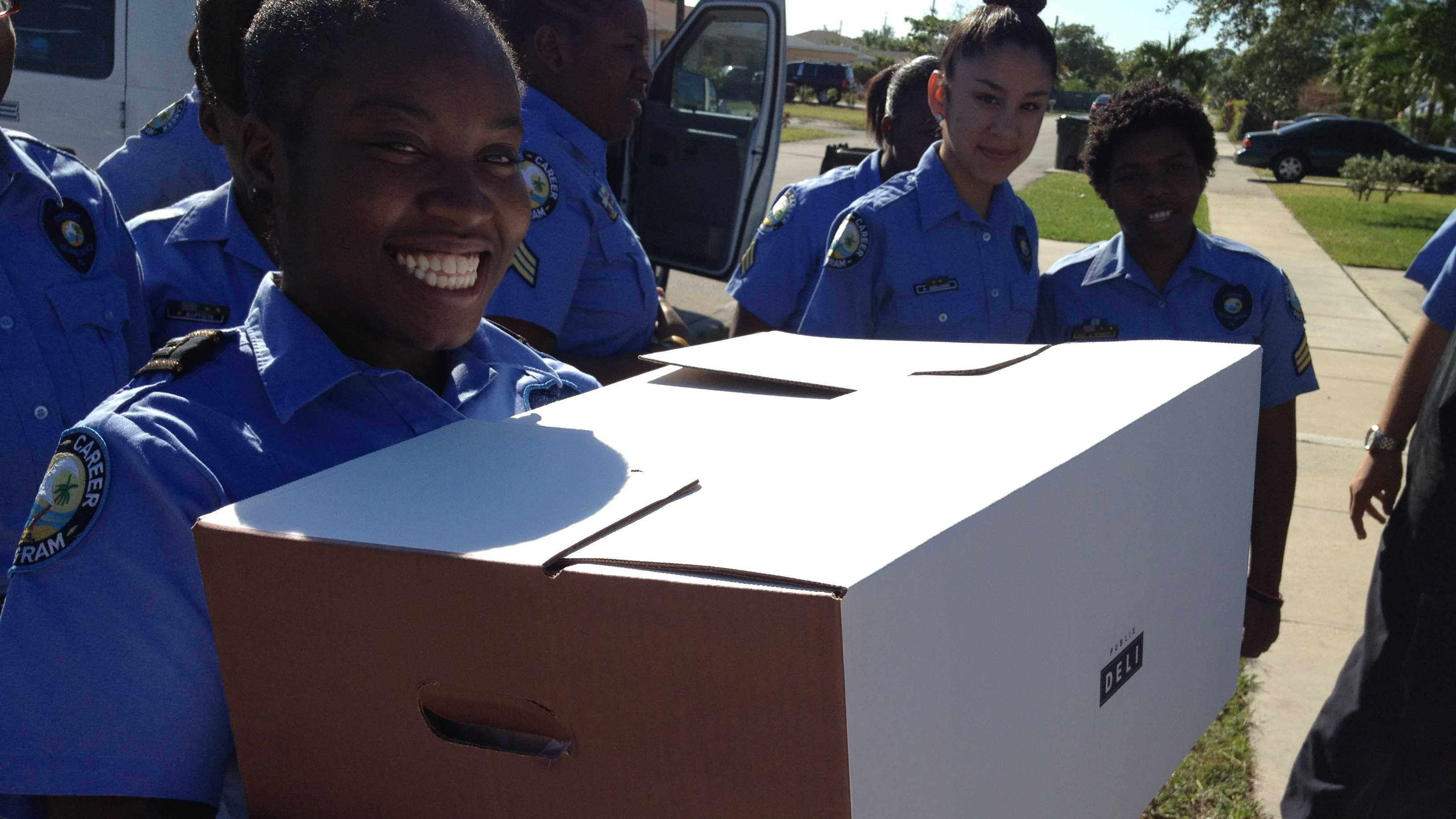 Criminal justice students at Atlantic High School deliver turkeys and pies to needy families in Delray Beach.