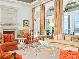 This exquisite living room offers views of the Intracoastal Waterway, as do all the major rooms in the mansion.