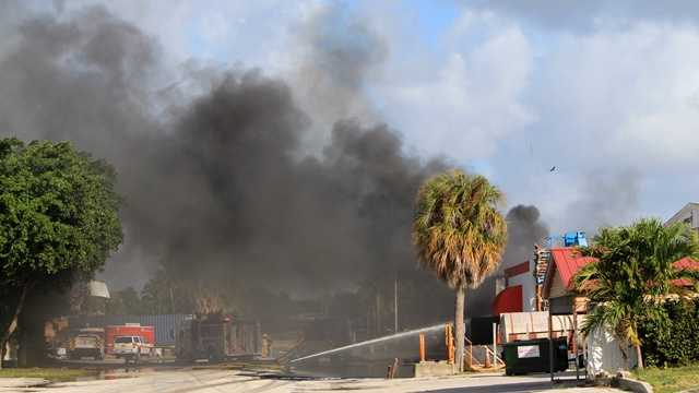 Fire ripped through a West Palm Beach tire store late on the evening of Dec. 1. (Photo: John P. Wise/WPBF)