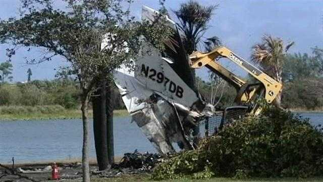 The tail of a Cessna 421 that crashed at John Prince Park is removed from the scene of the wreckage.