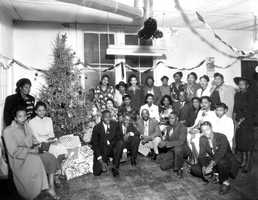 1948: A group of Lays Potato Chip workers pose near the Christmas tree.