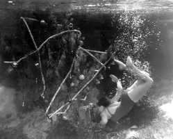 1948: A swimmer at Weeki Wachee decorates an underwater Christmas tree.