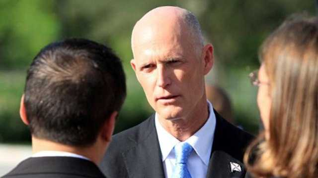 Gov. Rick Scott will be greeted by Satanist supporters outside his office Jan. 25. (Photo: John P. Wise/WPBF)