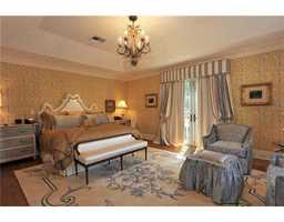 The master suite is one of 5 bedrooms in this home.