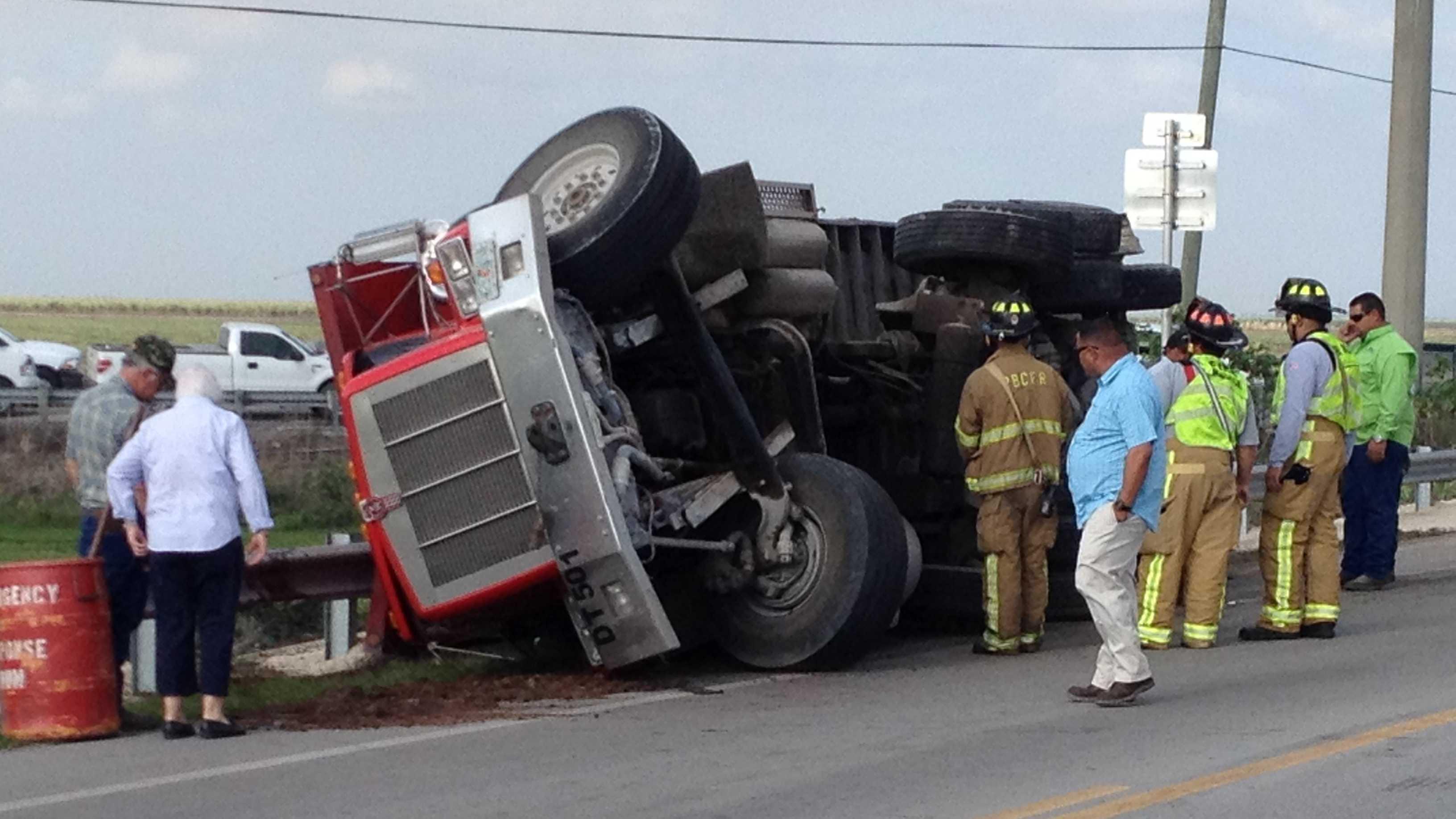 Tractor-trailer spills sugar cane