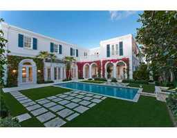 Exquisite view from the back of the home. From the sea blue shutters to the beautiful flowers across doors and columns, this backyard looks like a dream. Learn more about this beautiful home at realtor.com.