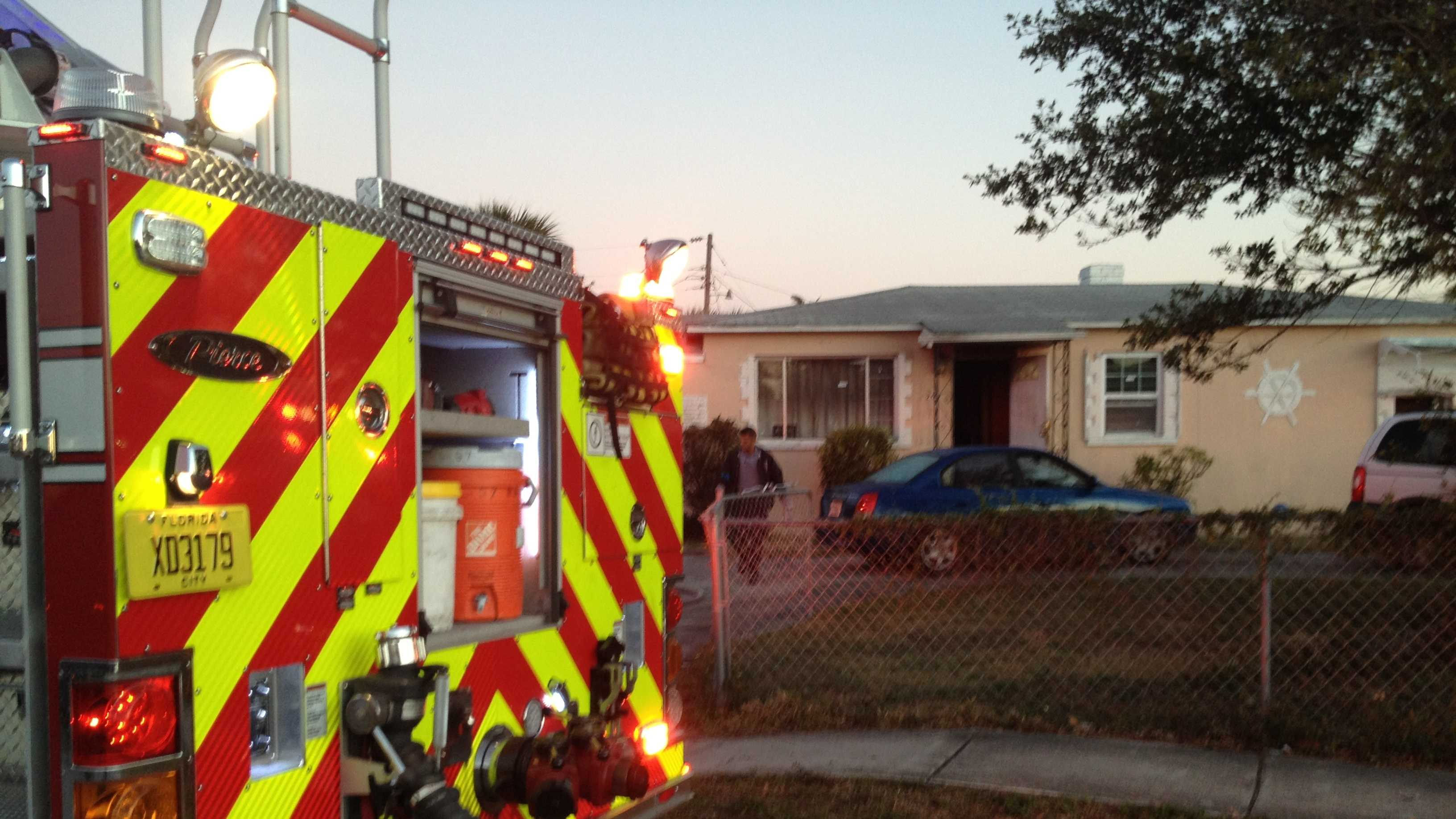 A family of three is OK after flames broke out at their home early Tuesday morning. (Photo: Chris McGrath/WPBF)