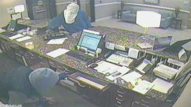 Police are searching for two gunmen who robbed a Holiday Inn Express in Port St. Lucie.
