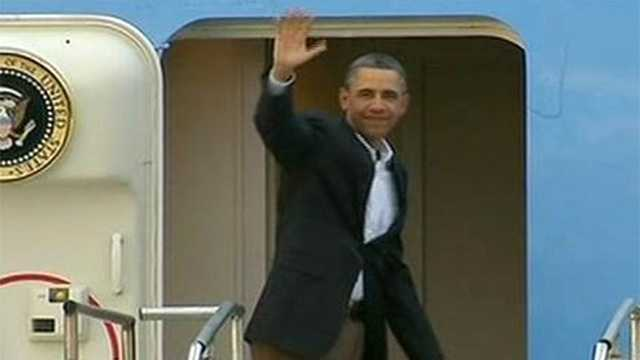 President Barack Obama waves to the cameras as he boards Air Force One and heads back to Washington following three days of golf in South Florida.