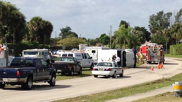 A Brinks truck turned on its side after an accident in Boca Raton on Tuesday morning. (Photo: Cathleen O'Toole/WPBF)