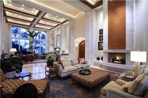 Bright ceilings and windows compliment this formal space.