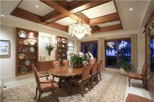 Stunning formal dining-room with a palm tree chandelier as the focal point.