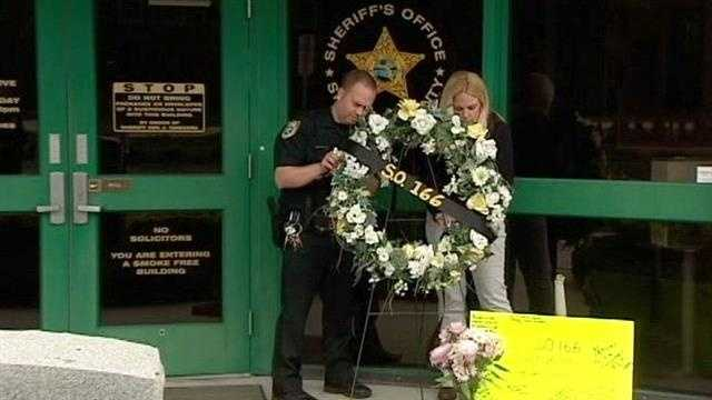 Friends and colleagues of Sgt Gary Morales pay their respects to the fallen deputy killed in the line of duty.