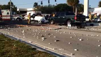 A pickup truck and another vehicle collided in Riviera Beach on Tuesday morning, sending two people to area hospitals. (Photo: Chris McGrath/WPBF)