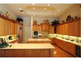 Beautiful kitchen with custom cabinetry and lighting.