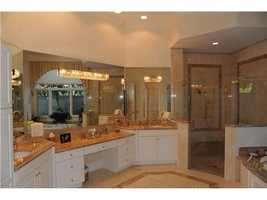 Exquisite master bathroom is one of 4 bathrooms in the home.