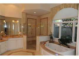 It has a massive spa tub and separate shower quarters.