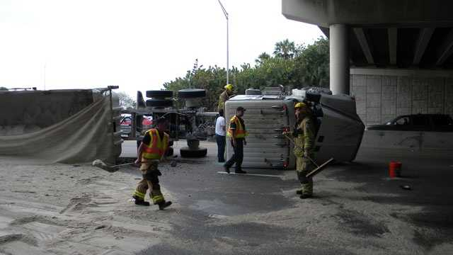 This truck overturned, spilling sand onto Atlantic Avenue in Delray Beach.