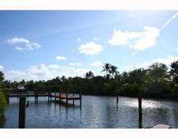 It features a private dock on Lake Worth Creek.