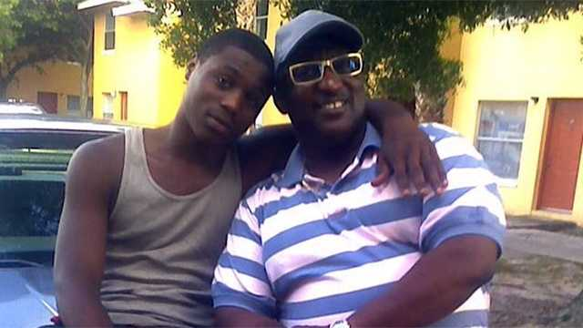 The Rev. Nathaniel Ferguson Sr. (right) is pictured with his son, who was shot dead in front of a West Palm Beach gas station in broad daylight Tuesday.