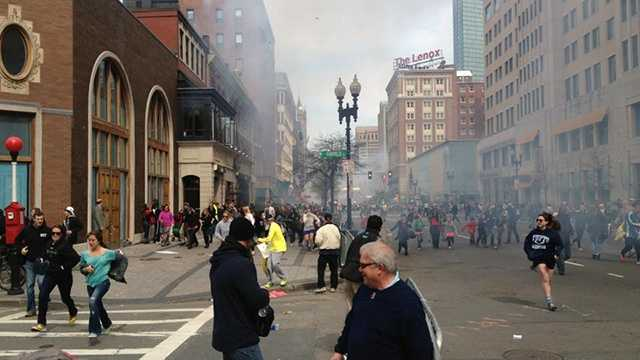 This picture taken moments after bombs rattled the Boston Marathon on Monday appears to show one of the suspects, Dzhokhar A. Tsarnaev, in the far left wearing a white baseball cap.
