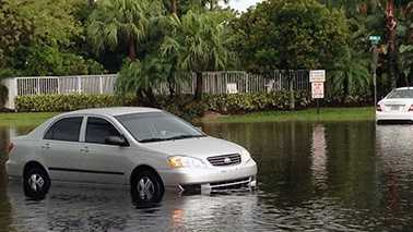 050213 378 Car in flooded road