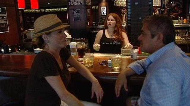 Some customers escape the rain during SunFest at Bar Louie on Clematis Street.